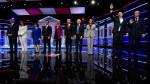 Democratic presidential candidates from left, Sen. Cory Booker, D-N.J., Rep. Tulsi Gabbard, D-Hawaii, Sen. Amy Klobuchar, D-Minn., South Bend, Ind., Mayor Pete Buttigieg, Sen. Elizabeth Warren, D-Mass., former Vice President Joe Biden, Sen. Bernie Sanders, I-Vt., Sen. Kamala Harris, D-Calif., former technology executive Andrew Yang and investor Tom Steyer wave to the audience before a Democratic presidential primary debate, Wednesday, Nov. 20, 2019, in Atlanta. (AP Photo/John Amis)