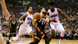 Toronto Raptors guard Fred VanVleet (23) drives to the net under pressure from Orlando Magic guard Markelle Fultz (20) and teammate Jonathan Isaac (1) during first half NBA basketball action in Toronto, Wednesday, Nov. 20, 2019. THE CANADIAN PRESS/Frank Gunn