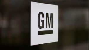 FILE - This May 16, 2014, file photo, shows the General Motors logo at the company's world headquarters in Detroit. (AP Photo/Paul Sancya, File)