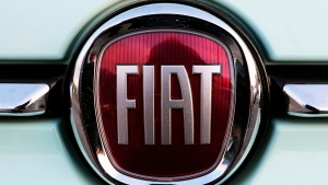 FILE - In this Oct. 31, 2019 file photo, a Fiat logo is pictured on a car in Bayonne, southwestern France. (AP Photo/Bob Edme, File)