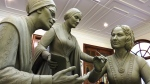 This Nov. 4, 2019, still image from video shows a portion of the first women's statue that will be installed in New York's Central Park, as it is being created by sculptor Meredith Bergmann in her studio in Ridgefield, Conn. The monument is scheduled to be dedicated Aug. 26, 2020, marking the 100th anniversary of American women winning the right to vote. (AP Photo/Joseph Frederick)