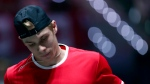 Canadian Denis Shapovalov looks down during his match against Australian tennis player Alex de Minaur during the Davis Cup tennis match in Madrid, Spain, Thursday, Nov. 21, 2019. (AP Photo/Manu Fernandez)