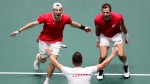 Canada's Vasek Pospisil, right, and Denis Shapovalov celebrate after winning against Australia's John Peers and Jordan Thompson during their Davis Cup double tennis match in Madrid, Spain, Thursday, Nov. 21, 2019. (AP Photo/Manu Fernandez)