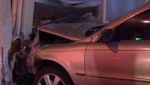 An impaired driver has been taken into custody after crashing his car into a store front early this morning.