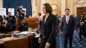 Former White House national security aide Fiona Hill, walks to her seat to testify before the House Intelligence Committee on Capitol Hill in Washington, Thursday, Nov. 21, 2019, during a public impeachment hearing of President Donald Trump's efforts to tie U.S. aid for Ukraine to investigations of his political opponents. (AP Photo/Manuel Balce Ceneta)