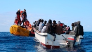 SOS Mediterranee team members from the humanitarian ship Ocean Viking approach a boat in distress with 30 people on board in the waters off Libya, Wednesday, Nov. 20, 2019. Ocean Viking, operated by Doctors Without Borders (Medecins Sans Frontiers MSF) anD SOS Mediterranee, has rescued another 30 people from a boat in distress off the Libyan coast, bringing the total number of migrants aboard the rescue vessel to 125. (Hannah Wallace Bowman/MSF via AP)