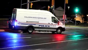Police collision investigators are seen on Stevenson Road South on Nov. 22, 2019 after a female cyclist was struck and killed.