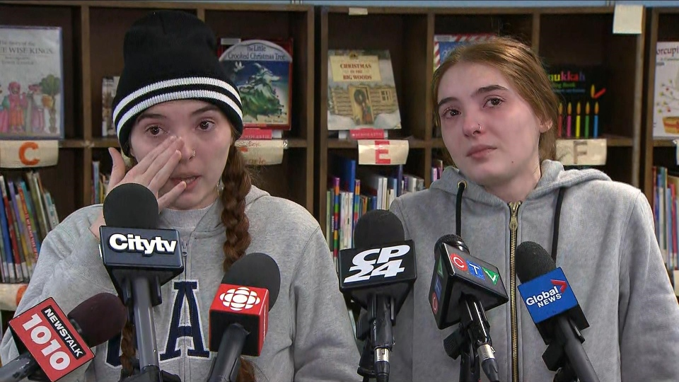 Julia Viana (left) and Daniela Viana speak with reporters about what life has been like since a fire at 235 Gosford Boulevard forced their family out of their home. (CP24)