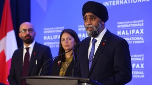 Harjit Singh Sajjan, Minister of National Defence, speaks, as Peter Van Praagh, President Halifax Security Forum and Paz Magat, director of Peace With Women Fellowship, look on, during the opening news briefing before the start of the Halifax International Security Forum in Halifax on Friday November 22, 2019. THE CANADIAN PRESS/Tim Krochak