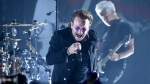 FILE - In this June 11, 2018 file photo, Bono of U2 performs during a concert at the Apollo Theater in New York. U2 raked in over $1 billion in sales to be named the artist of the decade by Pollstar. (Photo by Evan Agostini/Invision/AP, File)