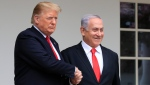 FILE - In this March 25, 2019, file photo, President Donald Trump welcomes visiting Israeli Prime Minister Benjamin Netanyahu to the White House in Washington. (AP Photo/Manuel Balce Ceneta, File)
