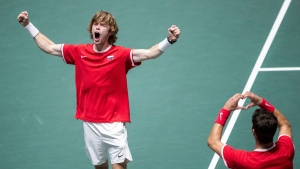 Russia's Karen Khachanov, right, and Andrey Rublev celebrate after winning the Davis Cup quarterfinal doubles match against Serbia's Novak Djokovic and Viktor Troicki in Madrid, Spain, Friday, Nov. 22, 2019. (AP Photo/Bernat Armangue)