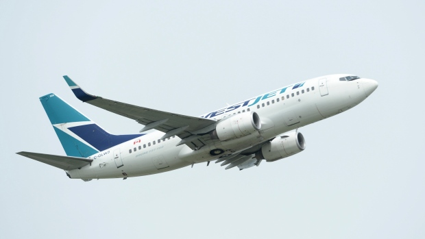 A WestJet plane takes off from Vancouver International Airport in Vancouver on Monday, May 13, 2019. THE CANADIAN PRESS/Jonathan Hayward