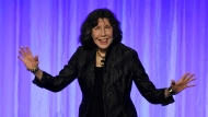 "Honoree Lily Tomlin arrives onstage to collect her award at ""The Paley Honors: A Special Tribute to Television's Comedy Legends"" at the Beverly Wilshire Hotel, Thursday, Nov. 21, 2019, in Beverly Hills, Calif. (Photo by Chris Pizzello/Invision/AP)"