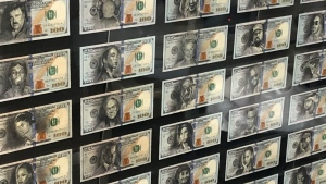 """The Many Faces of Benjamin Franklin,"" a gift to rapper Drake from his tattoo artist, Inal Bersekov, is shown in a handout photo. The visual art project turned 50 real U.S. $100 bills into a framed showcase of entertainers, sports icons and politicians. THE CANADIAN PRESS/HO, Inal Bersekov *MANDATORY CREDIT*"