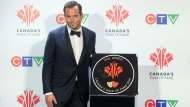 Actor Will Arnett is pictured with his star as he is inducted into Canada's Walk of Fame during an event in Toronto on Saturday, November 23, 2019. THE CANADIAN PRESS/Chris Young