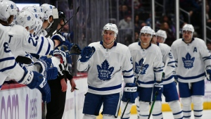 Toronto Maple Leafs defenseman Tyson Barrie (94) celebrate with the bench after his goal in the first period of an NHL hockey game against the Colorado Avalanche Saturday, Nov. 23, 2019 in Denver. (AP Photo/John Leyba)
