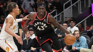 Toronto Raptors' Pascal Siakam (43) drives around Atlanta Hawks' Trae Young, left, during the second half of an NBA basketball game Saturday, Nov. 23, 2019, in Atlanta. The Raptors defeated the Hawks 119-116. (AP Photo/Tami Chappell)