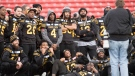 Members of the Hamilton Tiger Cats pose for a group photo during a practice prior to the 107th Grey Cup in Calgary, Saturday, Nov. 23, 2019. THE CANADIAN PRESS/Nathan Denette