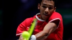 Canada's Felix Auger-Aliassime returns the ball to Spain's Roberto Bautista Agut during their tennis singles match of the Davis Cup final in Madrid, Spain, Sunday, Nov. 24, 2019. (AP Photo/Manu Fernandez)