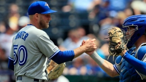 Toronto Blue Jays relief pitcher Justin Shafer (50) shakes hands with catcher Reese McGuire, right, following a baseball game against the Kansas City Royals at Kauffman Stadium in Kansas City, Mo., Wednesday, July 31, 2019. (AP Photo/Orlin Wagner)