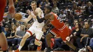 Toronto Raptors guard Matt Thomas (21) drives to the net on Chicago Bulls guard Kris Dunn (32) during the second half of their NBA basketball game in Toronto, Sunday, Oct. 13, 2019. THE CANADIAN PRESS/ Cole Burston