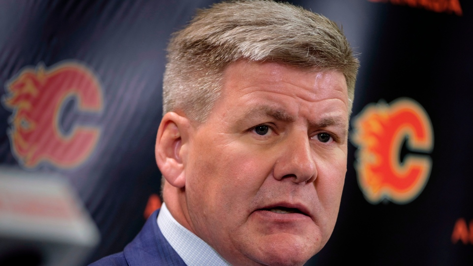 In this April 23, 2018, file photo, new Calgary Flames NHL hockey team head coach Bill Peters speaks to the media in Calgary, Alberta. (Jeff McIntosh/The Canadian Press via AP, File)