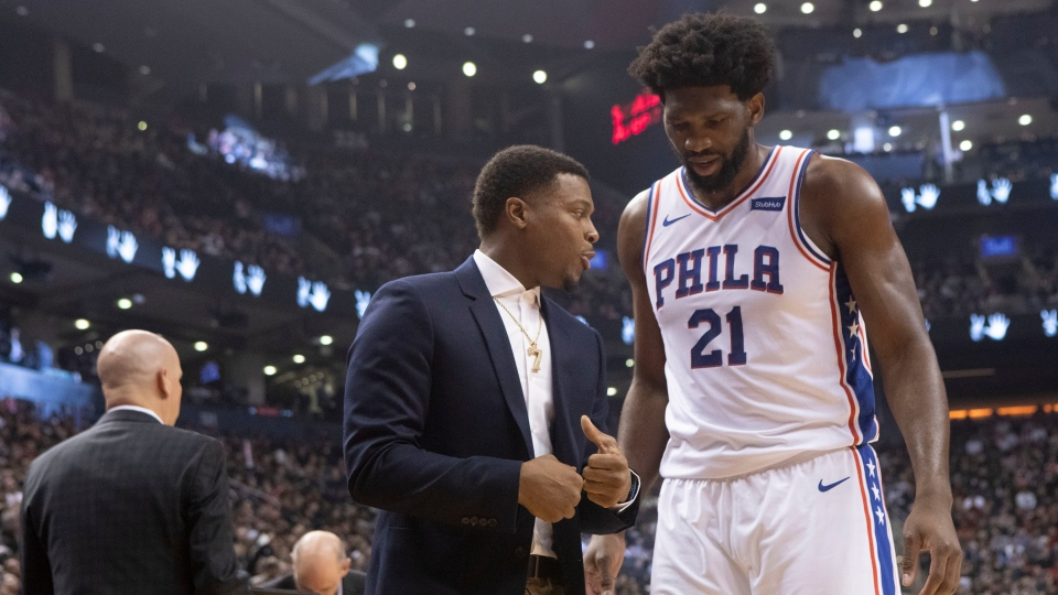 Philadelphia 76ers Joel Embiid passes Toronto Raptors Kyle Lowry as he walks off the court after his team's 101-96 loss in NBA basketball action in Toronto on Monday November 25, 2019. THE CANADIAN PRESS/Chris Young