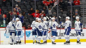 Toronto Maple Leafs celebrate their 6-0 win against the Detroit Red Wings after an NHL hockey game Wednesday, Nov. 27, 2019, in Detroit. (AP Photo/Paul Sancya)