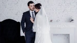 Bobmurod Nabiev and Sabina Usmanova are pictured in a wedding photo provided by a friend. (Submitted)