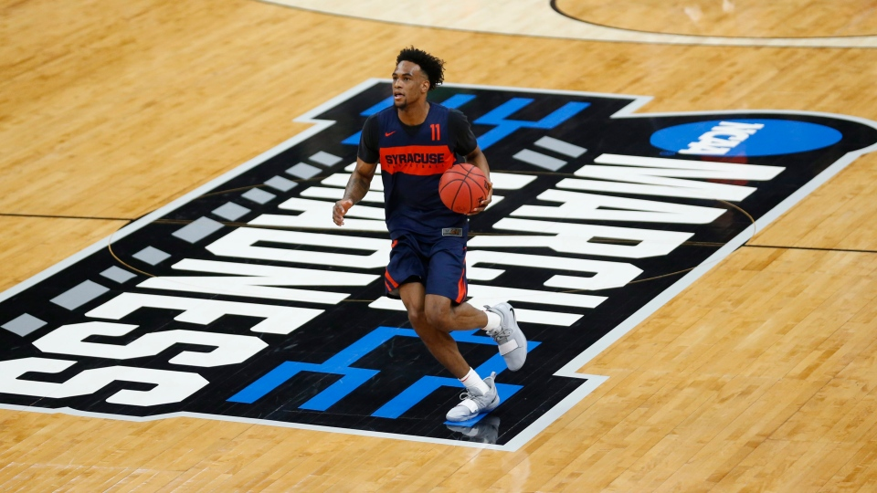 Syracuse's Oshae Brissett brings the ball up court during practice at the NCAA men's college basketball tournament Wednesday, March 20, 2019, in Salt Lake City. (AP Photo/Rick Bowmer)