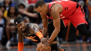Orlando Magic's Terrence Ross, left, and Toronto Raptors' Norman Powell battle for a loose ball during the second half of an NBA basketball game, Friday, Nov. 29, 2019, in Orlando, Fla. (AP Photo/John Raoux)