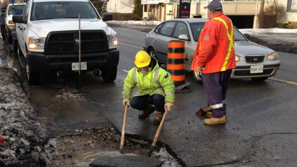 City crews repair a pothole in the Yonge and Sheppard area in this file photo. (Peter LeClair/CTV News Toronto)