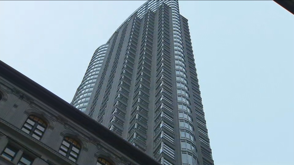 Glass has reportedly fallen from a skyscraper at King Street West and Yonge Street.