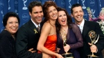 "FILE - In this Sept. 10, 2000, file photo, Shelley Morrison, from left, Eric McCormack, Debra Messing, Megan Mullally and Sean Hayes celebrate their awards for their work in ""Will & Grace"" at the 52nd annual Primetime Emmy Awards in Los Angeles. (AP Photo/Kevork Djansezian, File)"