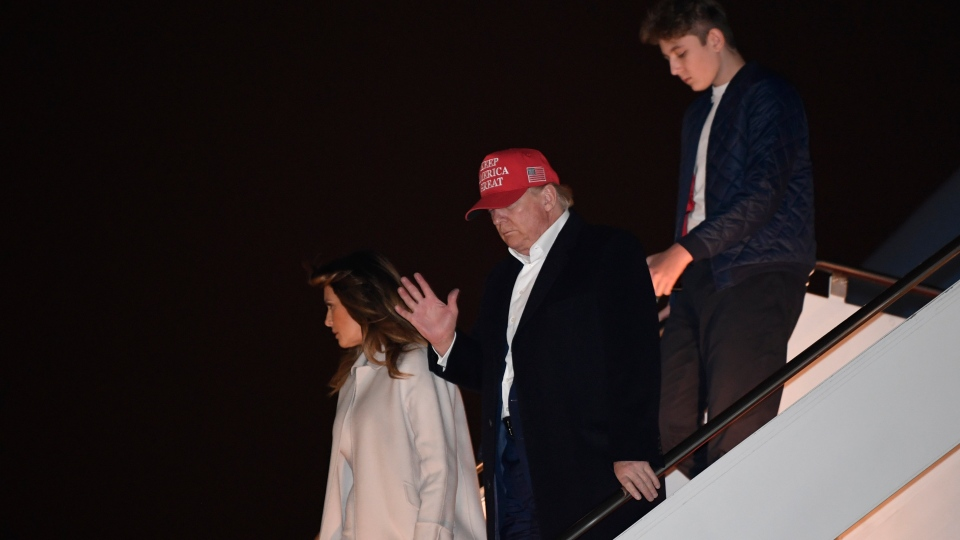 President Donald Trump, first lady Melania Trump and their son Barron Trump, walk down the steps of Air Force One at Andrews Air Force Base in Md., Sunday, Dec. 1, 2019. The Trumps are returning from Florida where they spent the Thanksgiving holiday at their Mar-a-Lago estate. (AP Photo/Susan Walsh)