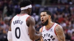 Toronto Raptors' Fred VanVleet (23) reacts with teammate Terence Davis II against the Utah Jazz during second half NBA basketball action in Toronto, Sunday, Dec. 1, 2019. THE CANADIAN PRESS/Hans Deryk