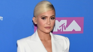 In this Monday, Aug. 20, 2018 file photo, Kylie Jenner arrives at the MTV Video Music Awards at Radio City Music Hall in New York. At 21, Jenner has been named the youngest-ever, self-made billionaire by Forbes magazine in March 2019. (Photo by Evan Agostini/Invision/AP)