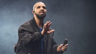 FILE - In this Oct. 8, 2016 file photo, Drake performs onstage in Toronto. The rapper has been named Spotify's most-streamed artist of the decade. (Photo by Arthur Mola/Invision/AP, File)