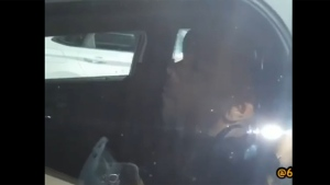 This still image taken from a video posted to Reddit shows a Toronto police officer with his eyes closed while in a parked cruiser.