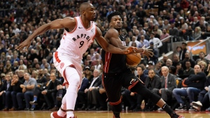 Miami Heat forward Jimmy Butler (22) drives past Toronto Raptors forward Serge Ibaka (9) during second half NBA action in Toronto on Tuesday, Dec.3, 2019. THE CANADIAN PRESS/Nathan Denette