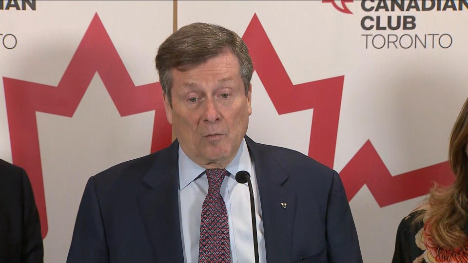 Mayor John Tory speaks with reporters following a speech at the Canadian Club on Wednesday.