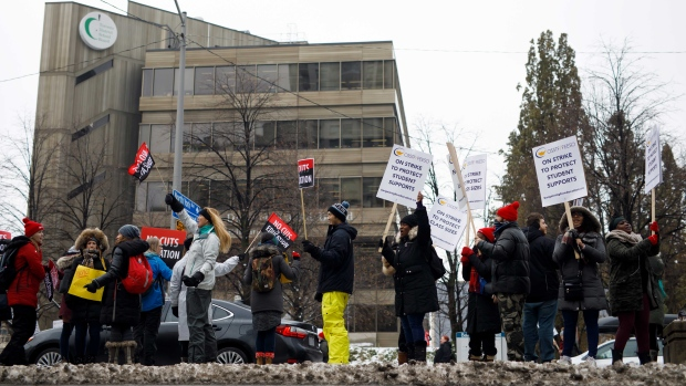 Striking teachers of the Ontario Secondary School Teachers Federation are seen picketing outside of the Toronto District School Board head office on Yonge Street in Toronto, Wednesday, Dec. 4, 2019. THE CANADIAN PRESS/Cole Burston