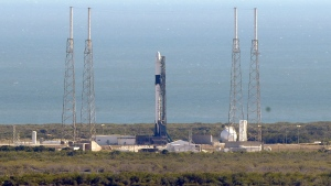 A Falcon 9 SpaceX rocket on a resupply mission to the International Space Station stands at Space Launch Complex 40 minutes after the launch attempt was scrubbed because of dangerous wind gusts at Cape Canaveral Air Force Staton in Cape Canaveral, Fla., Wednesday, Dec. 4, 2019. Another attempt is planned on Thursday. (AP Photo/John Raoux)