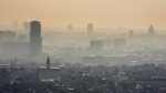 FILE - In this March 14, 2014 file photo a layer of smog covers the city of Brussels. The European Union says it will miss its targets for reducing planet-warming greenhouse gases by 2030 unless member states make a greater effort than they have so far. (AP Photo/Geert Vanden Wijngaert, file)