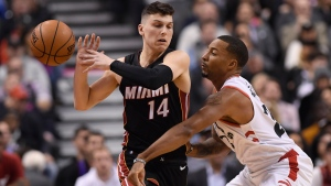 Toronto Raptors guard Norman Powell (24) knocks the ball out of Miami Heat guard Tyler Herro's hands during first half NBA action in Toronto on Tuesday, Dec.3, 2019. THE CANADIAN PRESS/Nathan Denette