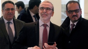Libya's Mustafa Sanalla Chairman National Oil Corporation arrives for a meeting of the Organization of the Petroleum Exporting Countries, OPEC at their headquarters in Vienna, Austria,, Thursday, Dec. 5, 2019. (AP Photo/Ronald Zak)