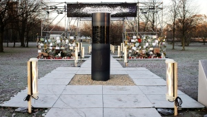 """An oversized urn covered with a black plastic wrap placed by the artist group 'Center for Political Beauty"""" near the German parliament building, the Reichstag in Berlin, Germany, Thursday, Dec. 5, 2019. An activist group has apologized to Jewish groups who expressed outrage at an urn placed in front of the German parliament that the activists claim contains Holocaust victims' remains. The Center for Political Beauty said late Wednesday they had not intended to hurt the feelings of Holocaust survivors and their descendants when they placed the urn in front of Reichstag building Monday. (Photo/Markus Schreiber)"""