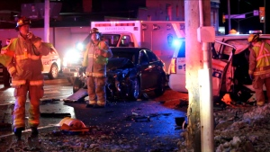 Emergency crews are shown at the scene of a collision involving a police vehicle in Oshawa.