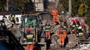 Firefighters and rescuers inspect the rubble of a house that collapsed in a gas explosion killing four adults and four children who lived there in the mountain resort of Szczyrk, southern, Poland, Thursday, Dec. 5 , 2019. (AP Photo)